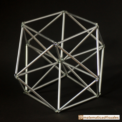Volume of a cuboctahedron: tubes,  the distance from the center to each vertice is the edge length   | matematicasvisuales