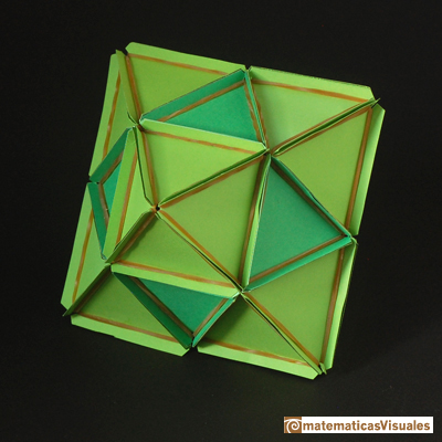 Volume of a cuboctahedron: a cuboctahedron and a octahedron made with rubber bands and paper | matematicasvisuales